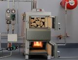 Отопительные котлы на твердом топливе: рациональное решение для обогрева дома