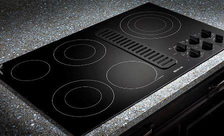 индукционная плита на современной кухне
